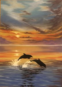 Dolphins swimming happily